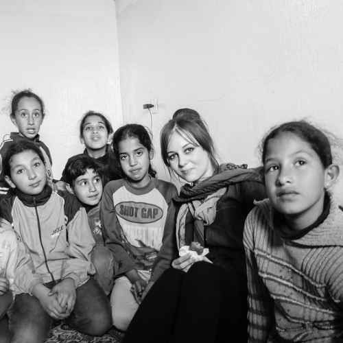 Bonnie Newman with Syrian refugees in Lebanon